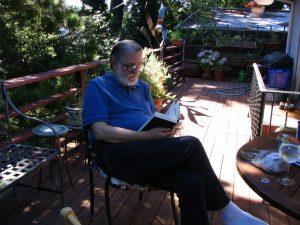 John Varley reading on Charlie's deck