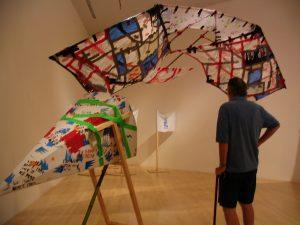 John Varley checking out Cruz Ortiz's art BCAM