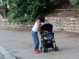 Down LA River Part 7: girl tending doll at Hollenbeck Park