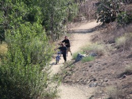 Down LA River Part 9: 2 boys walking bikes