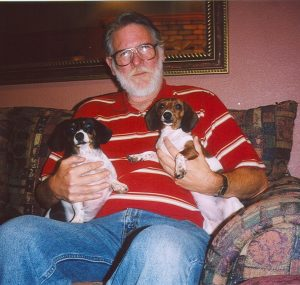 John Varley with wiener dogs