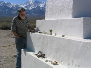 Manzanar: John Varley next to monument