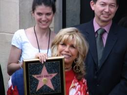 Nancy Sinatra holding star