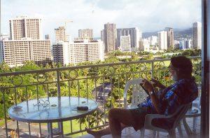 John Varley reading on balcony