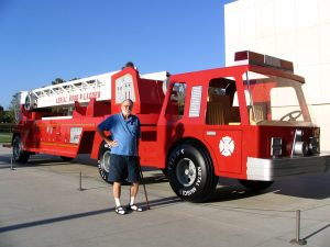 John Varley with toy fire engine by Charles Ray